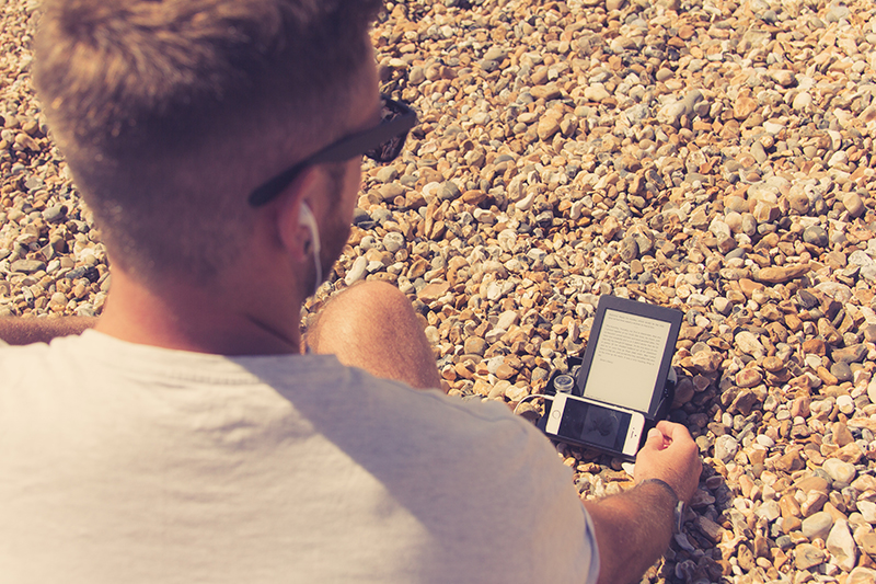 BOB on the beach with a kindle